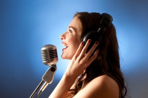 blonde_girl_singing_in_recording_studio